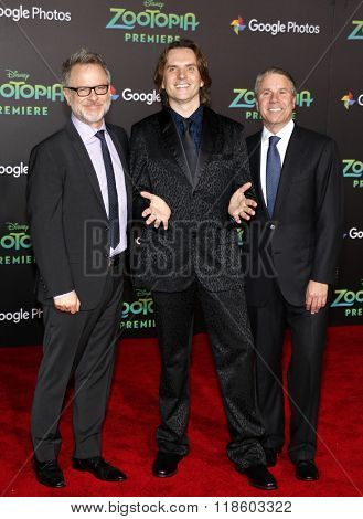 Byron Howard, Rich Moore and Clark Spencer at the Los Angeles premiere of 'Zootopia' held at the El Capitan Theater in Hollywood, USA on February 17, 2016.