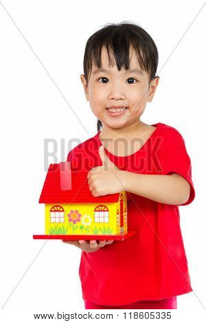 Asian Little Girl Holding House For Property Concept