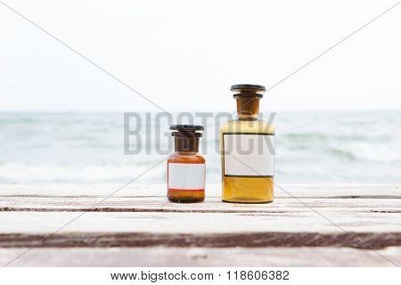 Vintage Medicine Bottles On Sea Background