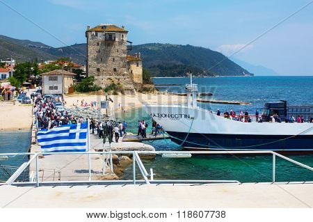 Tourists descend from the ship in port of Ouranoupoli, Greece