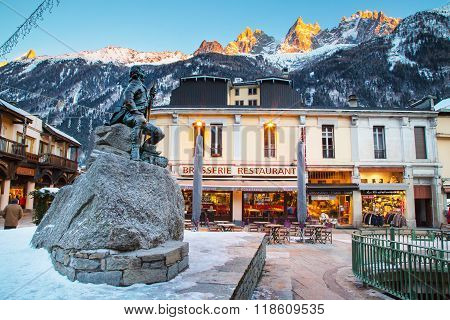 Dr Gabriel Paccard statue, Chamonix, France. Street and mountains view