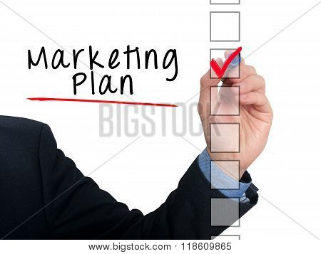 Businessman Hand Writing Marketing Plan And Check Listing Task