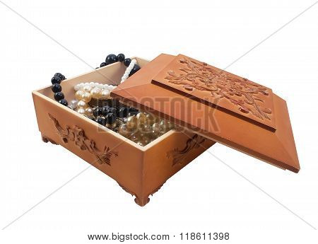 Isolated wooden casket with jewelry.