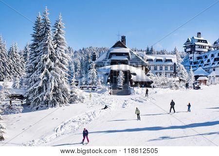 Panorama of ski resort Kopaonik, Serbia, people, houses covered with snow