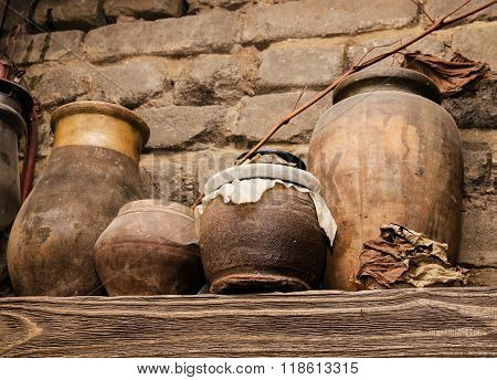 Old Pottery And Glass Flasks With A Kerosene Lamp