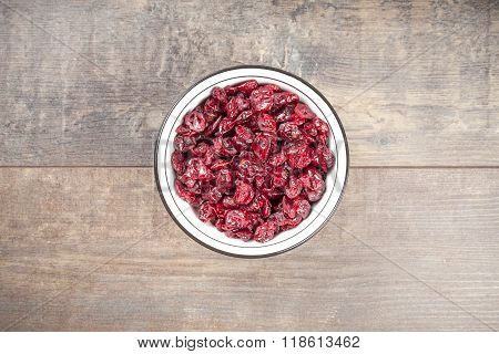 Dried Cranberries In A Bowl On Wooden Background