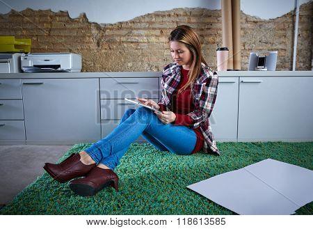 University student woman tablet doing homework sitting on home carpet