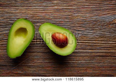 avocado cut on aged wood table board cutted half