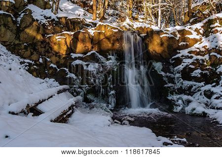 Winter Waterfall In The Forest