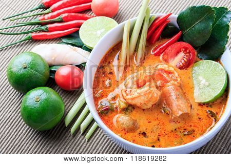 Thai Prawn Soup with Lemongrass (Tom Yum Goong) On Brown Cloth Background.
