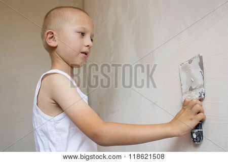 Boy Hand Using Trowel