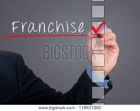 Businessman Hand Writing Franchise And Check Listing Task