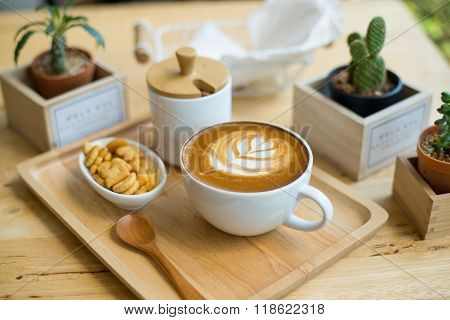 Hot Latte Art  With Cactus In Coffee Shop On Table Wooden