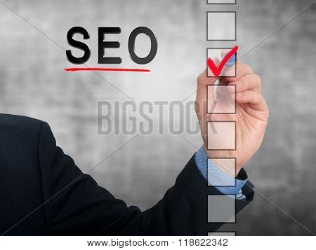 Businessman Checking Mark On Seo Checklist Marker