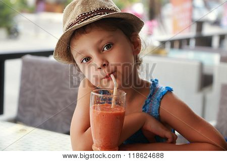 Fun Cute Kid Girl Drinking Healthy Smoothie Juice In Street Restaurant