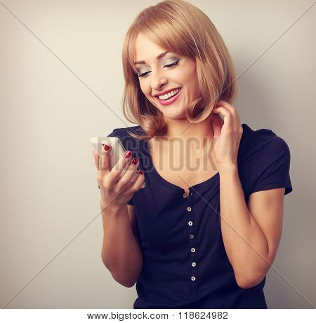Happy Smiling Blond Woman Chating In Mobile Phote. Toned Closeup Portrait