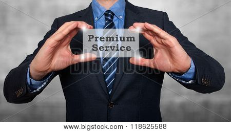 Businessman Holds Premium Service In His Hands