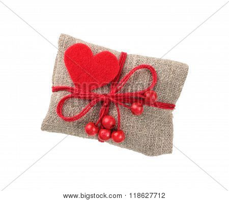 gift in sacking with red heart