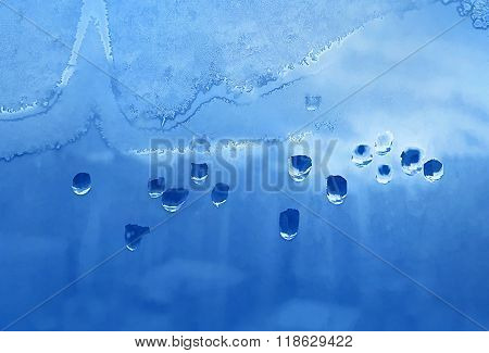 Water Drops, Ice Pattern And Sunlight On Window Glass