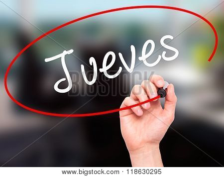 Man Hand Writing Jueves (thursday In Spanish) With Black Marker On Visual Screen