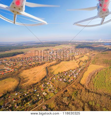 Drone flying and spying over your village. Digital artwork with fictional vehicle on UAV theme.