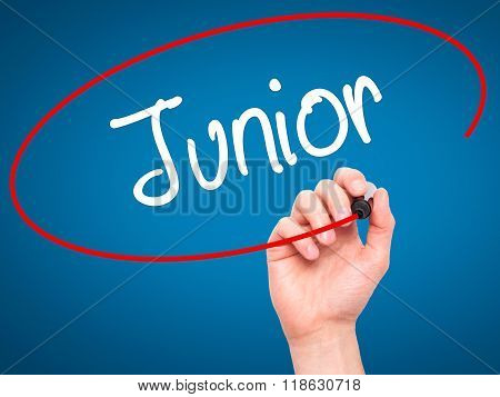 Man Hand Writing Junior With Black Marker On Visual Screen