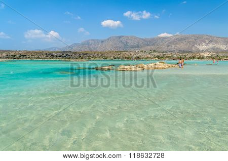 People have a joy at Elafonisi beach. Elafonisi beach is one of the most popular beaches on Crete is
