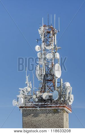 Telecommunication Tower With Dish And Mobile Antennas