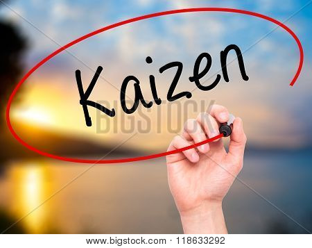 Man Hand Writing Kaizen With Black Marker On Visual Screen