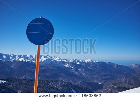 Empty  sign. Ski-track with Caucasus mountains on background. Ski vacation panorama on top of the mountain.