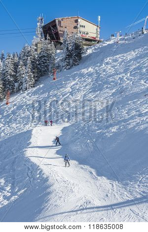 Tourists On A Ski Slope In Poiana Brasov