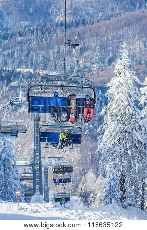 Tourists In Chairlift In Poiana Brasov Romania