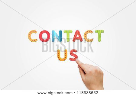 Hand Put The Words Contact Us With Magnetic Letters