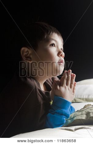 Saying his prayers before bed.