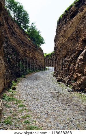 Cobblestone Road Between Cliff