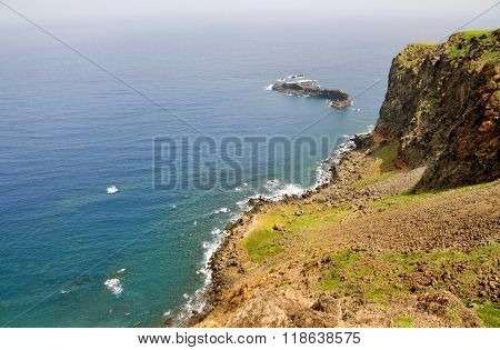 Rocky Coastline With Islet