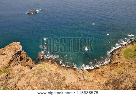 Rocky Coastline With Volcanic Islet