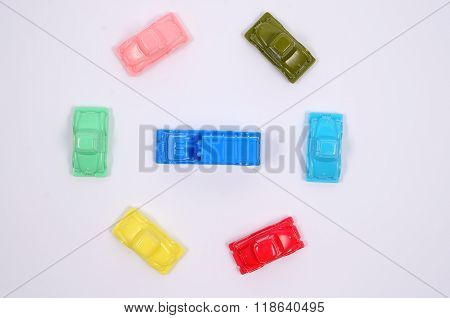Many cars surrounded one car.
