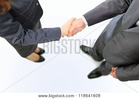 Handshake of the two businessmen agreed in the contract.