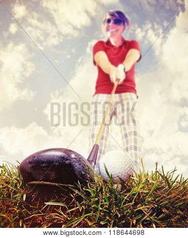 a person playing golf as seen through a wide angle lens toned with a retro vintage instagram like filter app or action