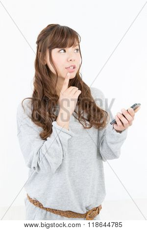 Young woman using cellular phone