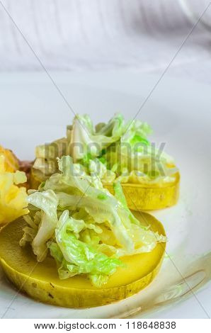 Mashed potatoes,meat slices of fried meat. Salad of Chinese cabbage