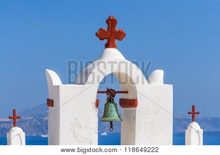 Bell tower of church above the beautiful blue bay at Santorini,Greece