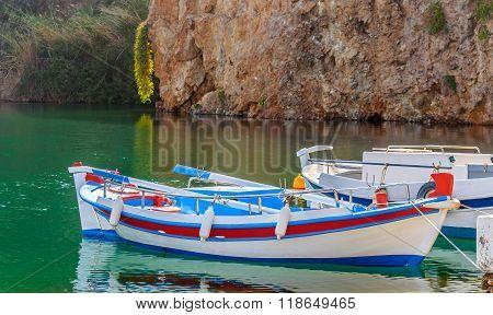 Traditional Greek boat at Aghios Nikolaos port on Crete island