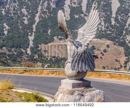 LASSITHI, CRETE, GREECE - AUGUST 16, 2013: View on the sculpture of eagle, near Homo Sapiens museum on Crete island.
