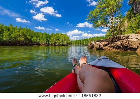 Woman relaxes on Kayak