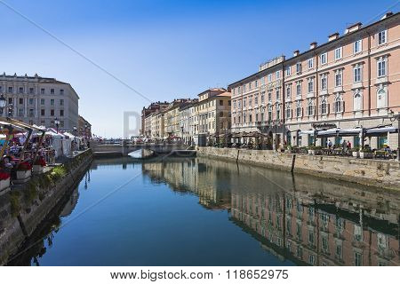 Buildings Reflected In The Calm Sea Water Of The Canal Grande, Trieste, Italy