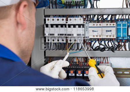 Male Technician Checking Fusebox