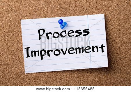 Process Improvement - Teared Note Paper Pinned On Bulletin Board