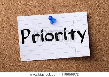 Priority - Teared Note Paper Pinned On Bulletin Board